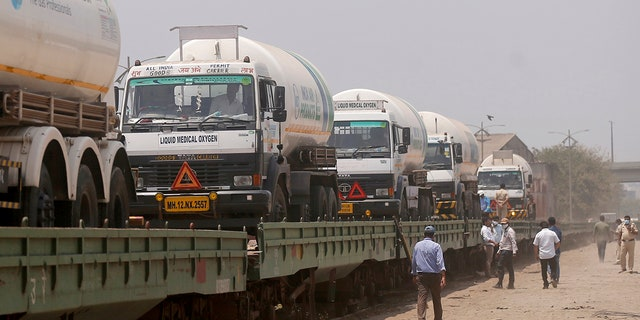 April 19, 2021: Empty tankers are loaded on a train wagon at the Kalamboli goods yard in Navi Mumbai, Maharashtra state, India, before they are transported to collect liquid medical oxygen from other states.