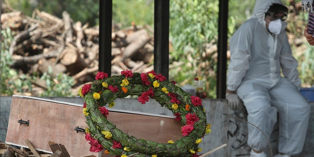 April 30, 2021: A wreath lies on the coffin of a COVID-19 victim before his cremation in Jammu, India.