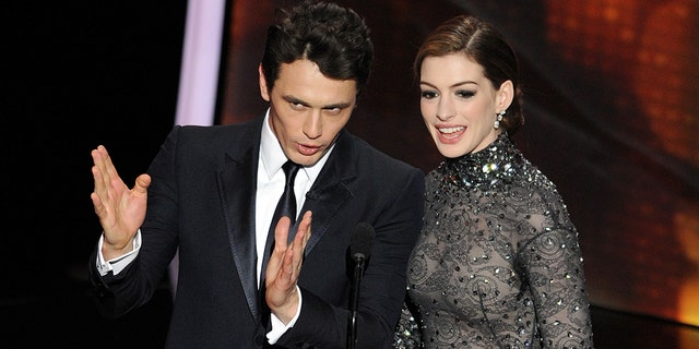 Actors James Franco, left, and Anne Hathaway present the 83rd Annual Academy Awards at the Kodak Theatre on February 27, 2011, in Hollywood, Calif. (Gabriel Bouys/AFP via Getty Images)