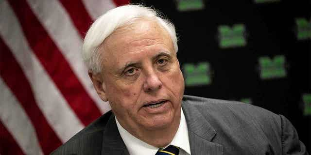 ,Jim Justice, West Virginia's Republican governor signed a bill Wednesday that bans transgender athletes from competing in female sports in middle and high schools and colleges.