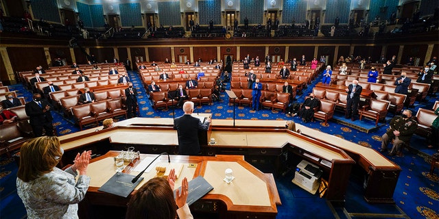 President Biden addresses a joint session of Congress, Wednesday, April 28, 2021, in the House Chamber at the U.S. Capitol in Washington, as Vice President Kamala Harris and House Speaker Nancy Pelosi of Calif., stand and applaud. (Melina Mara/The Washington Post via AP, Pool)
