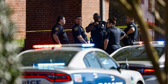 Knoxville police work the scene following a shooting at Austin-East Magnet High School in Knoxville, Tenn., Monday, April 12, 2021.
