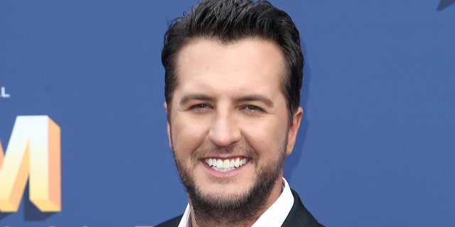 Luke Bryan won his third entertainer of the year award from the Academy of Country Music on Sunday, drawing mixed reactions from viewers. (Photo by Tommaso Boddi/Getty Images)