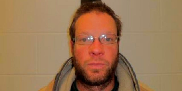 Michael Lang, of Grundy Center, Iowa. Lang, 41, is charged with murder in the April 9 shooting of Iowa State Patrol Sgt. Jim Smith during a violent standoff at his home. (Iowa Department of Corrections via AP)