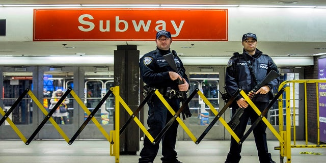 Police stand guard inside the Port Authority Bus Terminal on Dec. 11, 2017. (AP)