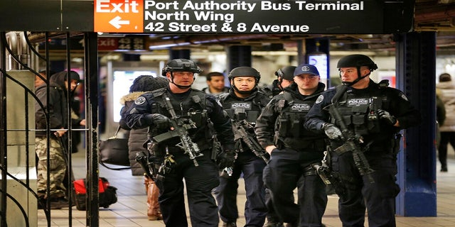 In this Dec. 12, 2017 photo, police officers patrol in the passageway connecting New York City's Port Authority bus terminal and the Times Square subway station, near the site of the explosion. (AP)