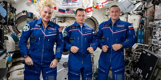 The three-member Expedition 64 crew from JAXA (Japan Aerospace Exploration Agency). From left are, Kate Rubins of NASA,Sergey Ryzhikov of Roscosmos and Sergey Kud-Sverchkov of Roscosmos.