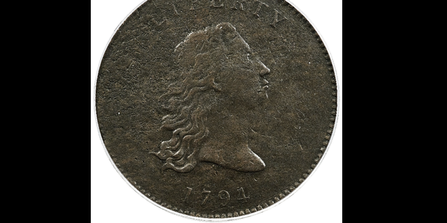 This undated photo provided by Heritage Auctions shows the front of a piece of copper that was struck by the U.S. Mint in Philadelphia in 1794 and was a prototype for the fledgling nation's money. (AP/Heritage Auctions)