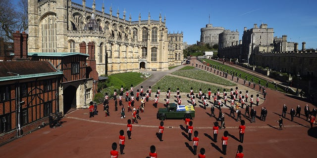 Members of the Royal family follow the coffin of Britain's Prince Philip during the funeral inside Windsor Castle.