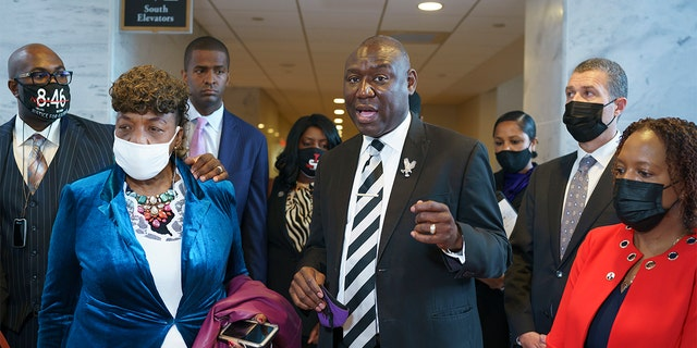 Civil rights attorney Ben Crump, who represented the George Floyd family, is joined by family members of victims of racial injustice following a meeting with Sen. Tim Scott, R-S.C., who is working on a police reform bill in the Senate, at the Capitol in Washington, Thursday, April 29, 2021. At left are Philonise Floyd, brother of George Floyd, and Gwen Carr, mother of Eric Garner who was killed by a New York Police Department officer using a prohibited chokehold during his arrest.