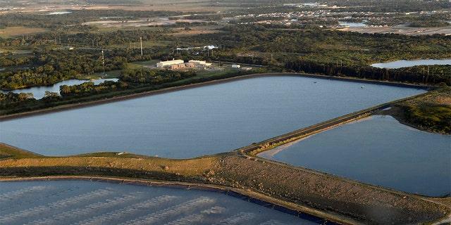 This photo shows a reservoir near the old Piney Point phosphate mine, Saturday, April 3, 2021, in Bradenton, Fla. (Tiffany Tompkins/The Bradenton Herald via AP)