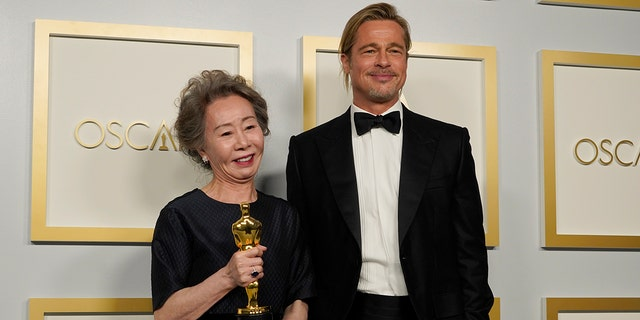 "Brad Pitt, right, poses with Yuh-Jung Youn, winner of the award for best actress in a supporting role for ""Minari,"" in the press room at the Oscars on Sunday, April 25, 2021, at Union Station in Los Angeles."