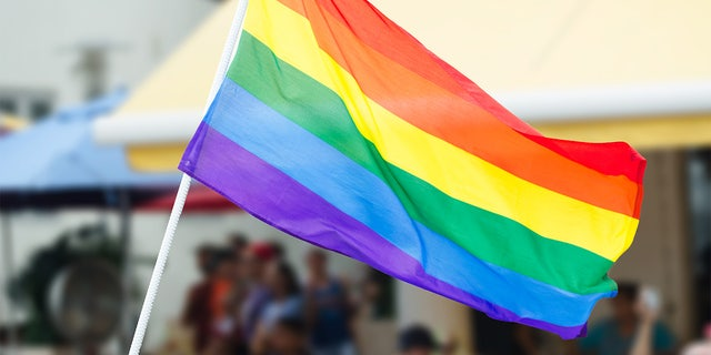 A rainbow flag is waved on the street during a gay pride celebration. Two organizers of a Pride Month event in Seattle are now facing criticism after writing a complaint about another event's