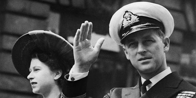 In this June 8, 1948 file photo, the Duke of Edinburgh seated beside Princess Elizabeth, acknowledges the cheers of the crowd as the open Landau passes through Fleet Street on way to the Guildhall in London. Buckingham Palace officials say Prince Philip, the husband of Queen Elizabeth II, has died, it was announced on Friday, April 9, 2021. He was 99. Philip spent a month in hospital earlier this year before being released on March 16 to return to Windsor Castle. Philip, also known as the Duke of Edinburgh, married Elizabeth in 1947 and was the longest-serving consort in British history.