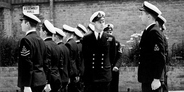 In this July 31, 1947 file photo, Lt. Philip Mountbatten, as he was then called, center, inspects his men at the Petty Officers' Training Center at Corsham, England. (AP Photo/File)