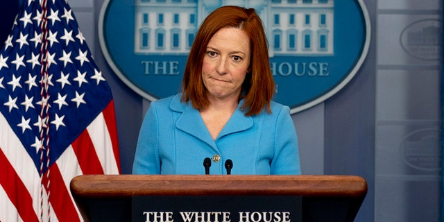 White House press secretary Jen Psaki takes a question at a press briefing at the White House, Thursday, April 8, 2021, in Washington. Psaki Monday had one of her most contentious exchanges with a reporter yet over the refugee cap. (AP Photo/Andrew Harnik)