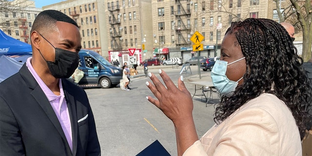 Rep. Ritchie Torres, D-N.Y. talks with a constituent in the Bronx.
