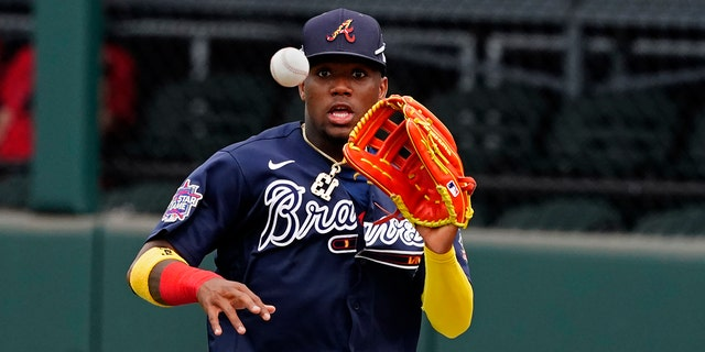Atlanta Braves right fielder Ronald Acuna Jr. fields a ball hit for a single by Boston Red Sox' Marwin Gonzalez in the fifth inning of a spring training baseball game on Monday, March 29, 2021, in North Port, Fla. Acuna threw to third and caught J.D. Martinez trying to advance. (AP Photo/John Bazemore)