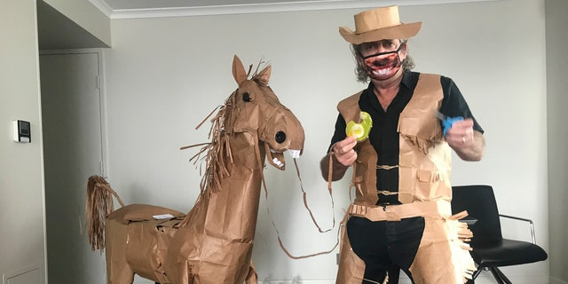 After creating his costume, Marriott went on to make himself a paper horse, which he named Russell. (David Marriott via AP)