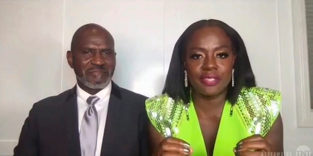 "In this video grab provided by the SAG Awards, Viola Davis, right, accepts the award for outstanding performance by a female actor in a leading role for ""Ma Rainey's Black Bottom,"" as her husband Julius Tennon looks on during the 27th annual Screen Actors Guild Awards on April 4, 2021."