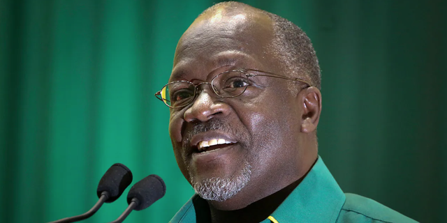 FILE - In this Saturday, July 11, 2015 file photo, Tanzania's then public works minister and presidential candidate John Magufuli speaks at an internal party poll to decide the ruling Chama Cha Mapinduzi (CCM) party's presidential candidate, which they later chose him to be, in Dodoma, Tanzania. (AP Photo/Khalfan Said, File)