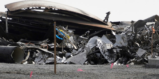 Debris is recovered from a National Wildlife Refuge after uncrewed SpaceX Starship prototype rocket SN11 failed to land safely, in Boca Chica, Texas, U.S. March 31,2021. REUTERS/Gene Blevins