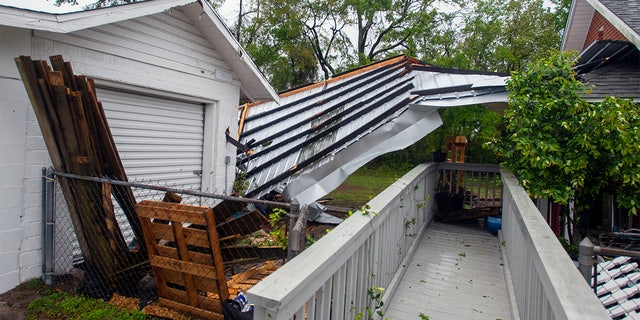A powerful storm ripped off the roof of Emerald Coast Brewing on West Government Street in Pensacola early on Saturday, April 10, 2021. Part of the roof landed at the business next door.Emerald Republic Brewing Roof Dammage 5