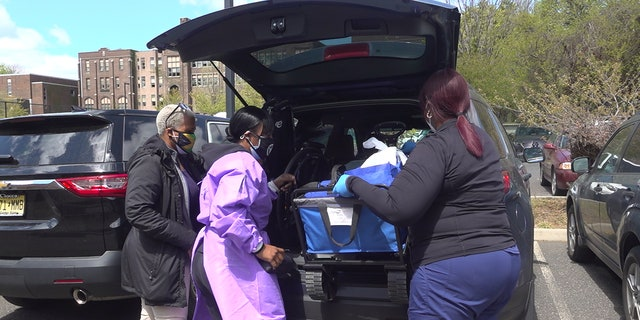 Dr. Ames-Lopez loads a vehicle up with COVID-19 vaccines for people who are homebound in Trenton, NJ. (Katie Byrne/Fox News)