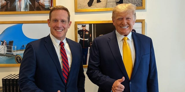 Republican Rep. Ted Budd of North Carolina meets with former President Donald Trump after holding a fundraiser for his burgeoning 2022 Senate campaign at Trump's Mar-a-Lago club in Palm Beach, Florida on Friday, April 23, 2021.