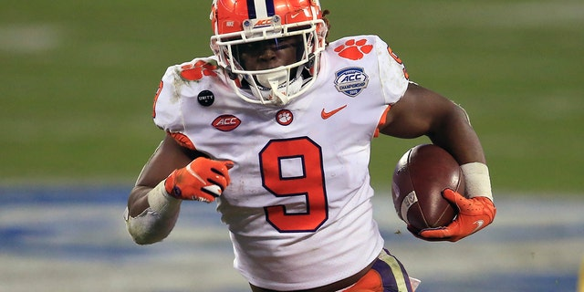 FILE - In this Saturday, Dec. 19, 2020 file photo, Clemson running back Travis Etienne (9) runs for a touchdown during the first half of the Atlantic Coast Conference championship NCAA college football game against Notre Dame in Charlotte, N.C. (AP Photo/Brian Blanco, File)