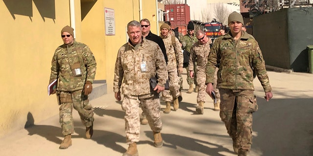 FILE - In this Jan. 31, 2020, file photo Marine Gen. Frank McKenzie, center, top U.S. commander for the Middle East, makes an unannounced visit in Kabul, Afghanistan. (AP Photos/Lolita Baldor, File)