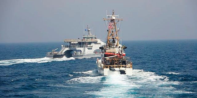 In an April 2, 2021, photo released by the U.S. Navy, an Iranian Revolutionary Guard vessels cut in front of the U.S. Coast Guard ship USCGC Monomoy in the Persian Gulf. (AP/US Navy)