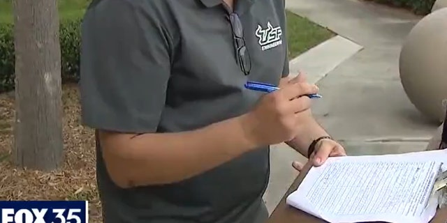 Man signs petition to make masks optional in schools (Credit: Fox 35 Orlando)