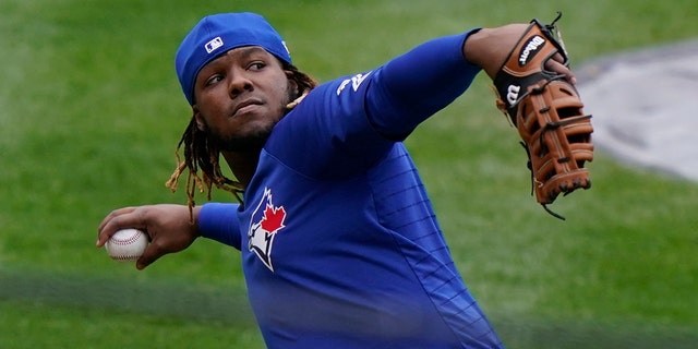 Toronto Blue Jays Vladimir Guerrero Jr. prepares to throw the ball in fielding drills during a workout, Wednesday, March 31, 2021, at Yankee Stadium in New York. The Blue Jays face the New York Yankees on opening day Thursday in New York. (AP Photo/Kathy Willens)