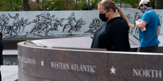 People visit the newly opened World War I memorial in Washington.  (Associated Press)