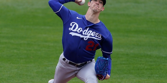 Los Angeles Dodgers starting pitcher Walker Buehler (21) throws during the first inning of a spring training baseball game against the Milwaukee Brewers Tuesday, March 23, 2021, in Phoenix, Ariz. (AP Photo/Ashley Landis)