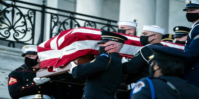 "The casket of slain U.S. Capitol Police officer William ""Billy"" Evans is carried from the Capitol by a joint services honor guard Washington on Tuesday. (AP/The Washington Post)"