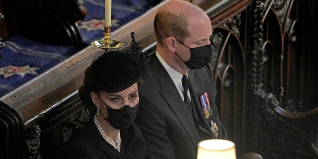 Britain's Prince William and Kate Duchess of Cambridge sit together at St. George's Chapel during the funeral for Prince Philip, at Windsor Castle, Windsor, England, Saturday April 17, 2021. Prince Philip died April 9 at the age of 99 after 73 years of marriage to Britain's Queen Elizabeth II.