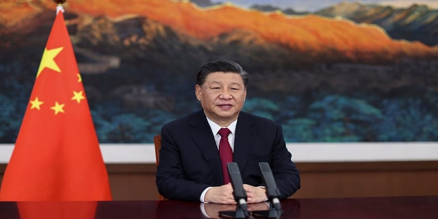 Chinese President Xi Jinping delivers a keynote speech via video for the opening ceremony of the Boao Forum for Asia Annual Conference, in Beijing, on Tuesday. (AP/Xinhua)