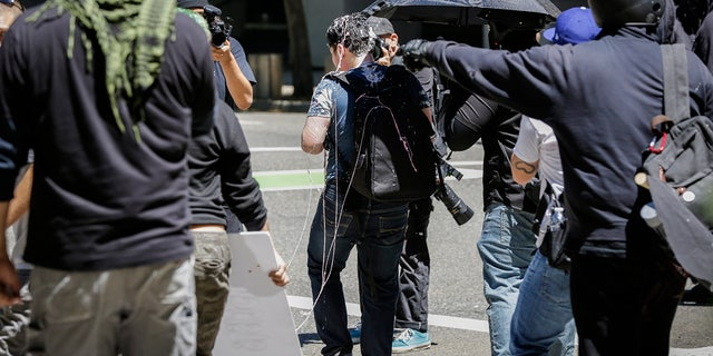 Andy Ngo covered in an unknown substance after unidentified Rose City Antifa members attacked him in 2019 in Portland, Ore.