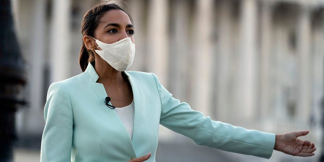Rep. Alexandria Ocasio-Cortez D-NY, speaks during a TV interview on Capitol Hill in Washington, Tuesday, April 20, 2021, after the jury returned guilty verdicts on all three charges in the murder trial of former Minneapolis police Officer Derek Chauvin in the death of George Floyd. (AP Photo/Jose Luis Magana)