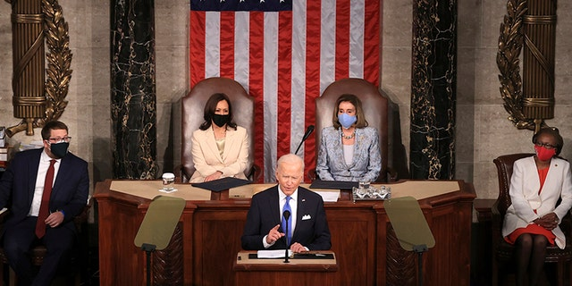 President Joe Biden addresses a joint session of Congress, Wednesday, April 28, 2021, in the House Chamber at the U.S. Capitol in Washington, as Vice President Kamala Harris, left, and House Speaker Nancy Pelosi of Calif., look on. (Chip Somodevilla/Pool via AP)