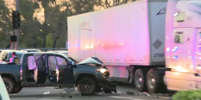 A murder suspect would also be wanted in connection with an alleged attack on a police officer who crashed into a semi-truck Tuesday night after a chase that stretched from San Diego to Los Angeles.  (Greetings: Mizael Cuatepotzo)