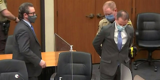 Former Minneapolis police officer Derek Chauvin is handcuffed to be led away after a jury found him guilty of all charges in his trial for second-degree murder, third-degree murder and second-degree manslaughter in the death of George Floyd in Minneapolis, Minnesota, U.S. April 20, 2021 in a still image from video. Pool via REUTERS
