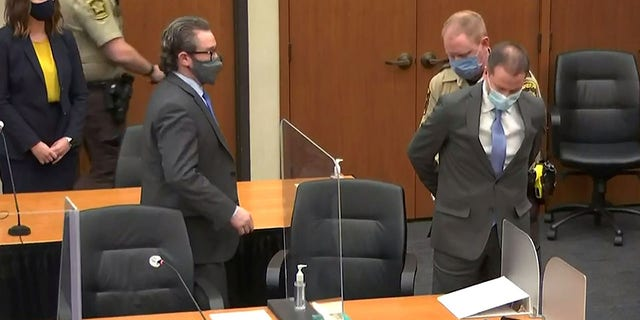 Former Minneapolis police Officer Derek Chauvin is handcuffed to be led away after a jury found him guilty of all charges in his trial for second-degree murder, third-degree murder and second-degree manslaughter in the death of George Floyd in Minneapolis, Minnesota, U.S. April 20, 2021 in a still image from video. (Reuters)
