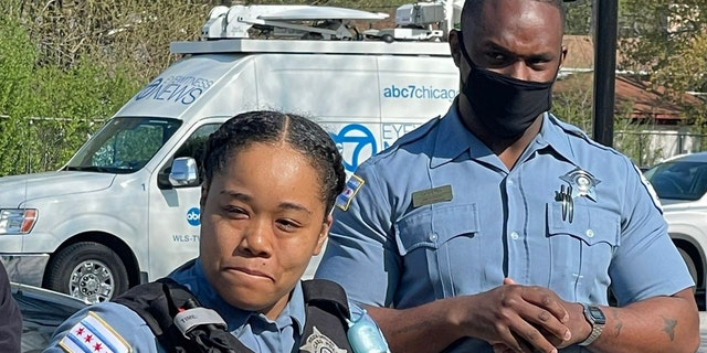 Officers Rhonda Ward (left) and Julius Givens (right) explained in a news conference how they rushedSwayseeRankin, 13, to the hospital after he was shot Monday night.