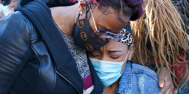 DMX's ex-wife, Tashera Simmons, left and his fiancée Desiree Lindstrom embraces during a prayer vigil outside White Plains Hospital on Monday, April 5th.