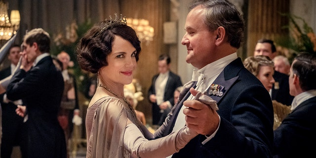 """This image released by Focus Features shows Elizabeth McGovern, left, as Lady Grantham and Hugh Bonneville, as Lord Grantham, in """"Downton Abbey."""""""