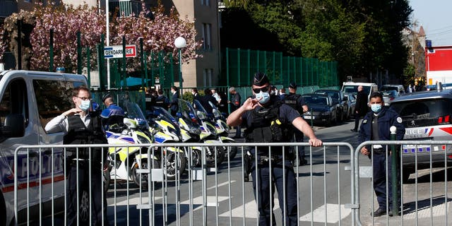 Police officers block the access with barriers next to the police station in Rambouillet, south west of Paris, Friday, April 23, 2021. (Associated Press)