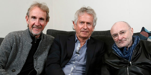 In this March 4, 2020 file photo, Genesis band members from left, Mike Rutherford, Tony Banks, and Phil Collins pose for a photo during an interview in London.